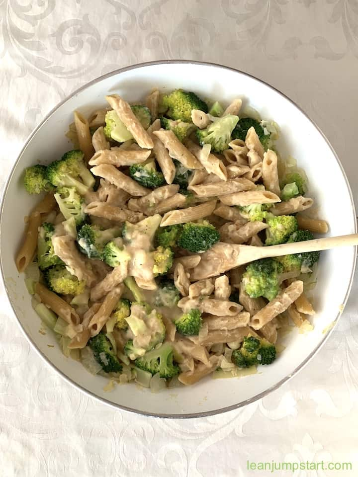 white bean pasta with broccoli in a skillet