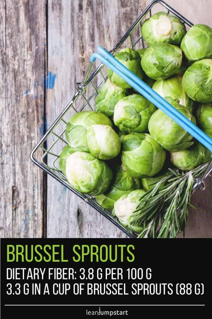 brussel sprouts in a metal basket on wood