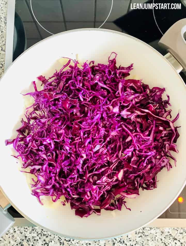 thinly sliced red cabbage in a pan