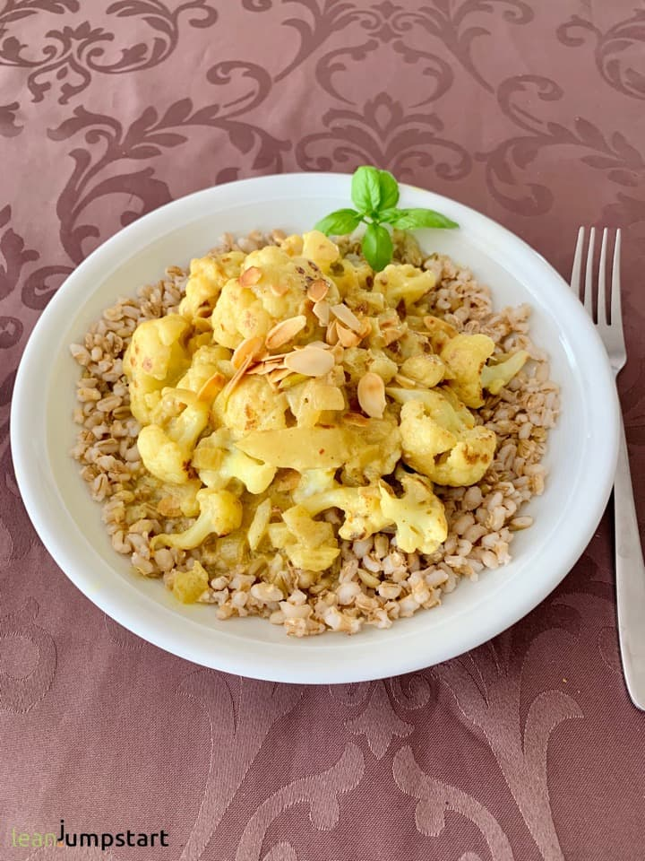 cauliflower coconut curry on a bed of grains